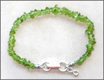 A handmade peridot anklet/bracelet, sterling silver clasp, Chi (Qi) jewelry for health. Healing jewelry, promote Qi (Chi) flow, for energy detox, pain reduction for repetitive strain (stress) injury, speeding up wound healing.