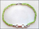 A handmade peridot anklet/bracelet, healing jewelry. promote Qi (Chi) flow, sterling silver clasp, good for Chi (Qi), chakra, acupuncture, alternative medicine, holistic medicine, health, wellbeing, happiness, harmony