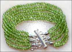 A handmade peridot bracelet, sterling silver clasp, good for Chi (Qi), chakra, acupuncture, alternative medicine, holistic medicine, health, wellbeing, happiness, harmony